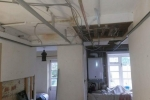 Tonbridge - Metal frame ceiling to cover existing wiring/pipework, before